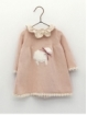 Knitted baby girl dress with little sheep