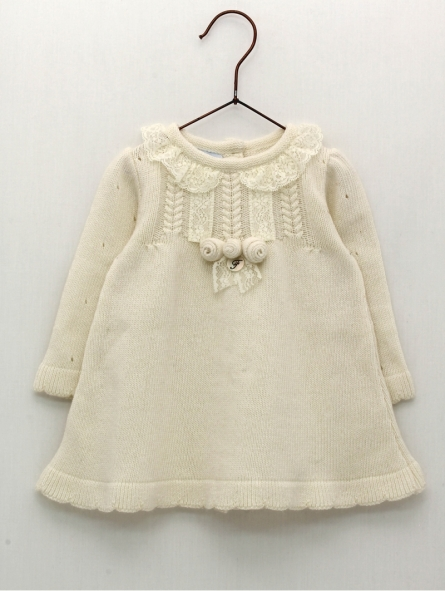 Knitted baby girl dress with flower ornament