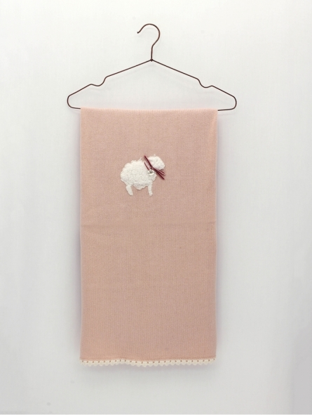 Knitted blanket with embroidery