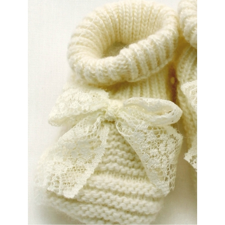Knitted boot-like booties with bow