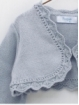Baby girl cardigan with round ends