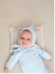 Capota bebé com pompón