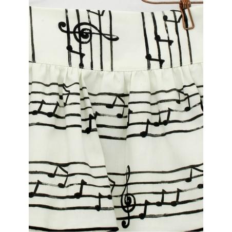 Falda niña estampado partitura