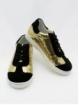Desportiva criança negra e dourada glitter